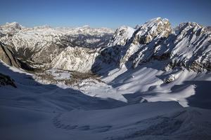 A Man Skis Down Forca Rossa Near the Marmolada Glacier Toward Malga Ciapelle by Ulla Lohmann