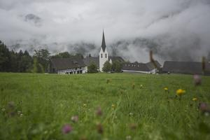 A Scenic View of Saint Gerold Monastery and a Hillside on a Rainy Day by Ulla Lohmann