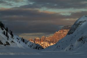 A View of Sunlight Illuminating Civetta from the Foot of the Marmolada Glacier by Ulla Lohmann