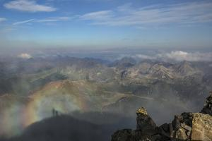 A View with Shadows of Two People, a Rainbow and Mountain Specter into Lagorei from the Cima D'Asta by Ulla Lohmann