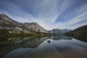 Boats on Calm Lago Di Cavedine Near Lago Di Garda by Ulla Lohmann