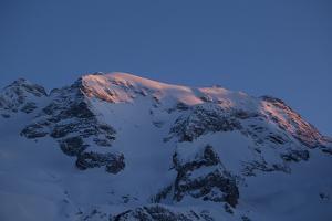 Pink Sunrise Light Strikes the Summit of Punta Penia, the Highest Point of Marmolada Glacier by Ulla Lohmann