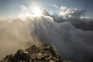 Sunlight Streams Through Clouds onto the Peak of Cima D'Asta by Ulla Lohmann