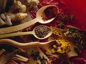 Assorted Spices in Wooden Spoons by Ulrike Koeb