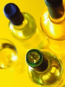 Three White Wine Bottles and a Wine Glass by Ulrike Koeb