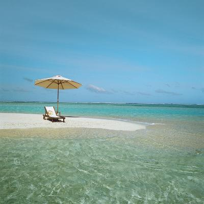 Umbrella and Beach Chair on the Beach--Photographic Print