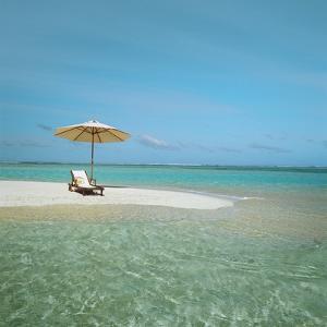 Umbrella and Beach Chair on the Beach