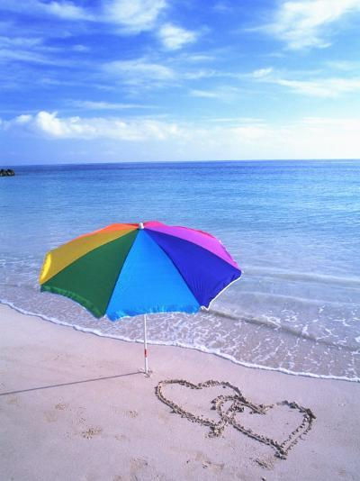 Umbrella on the Beach with Hearts Drawn in the Sand-Bill Bachmann-Photographic Print