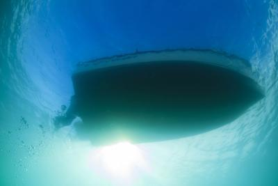 Underwater View of a Boat Hull Through the Waters of Florida Bay-James White-Photographic Print