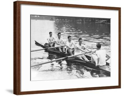 Eight man rowing