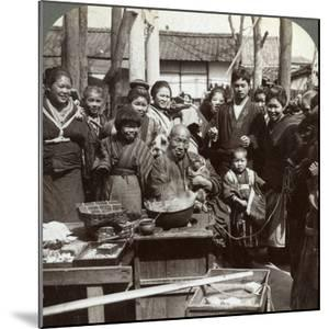 A Street Performer with a Monkey Amusing the Crowd, Kobe, Japan, 1896 by Underwood & Underwood