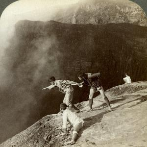 Gaving Through Sulphurous Vapors into the Crater's Depths, Aso-San, Japan, 1904 by Underwood & Underwood