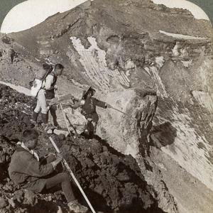 Peering from the Lava Encrusted Rim Down into Mount Fuji's (Fujiyama) Crater, Japan, 1904 by Underwood & Underwood
