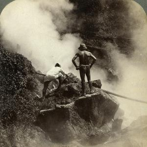 Watching an Eruption of Steam and Boiling Mud Halfway Up the Volcano of Aso-San, Japan, 1904 by Underwood & Underwood
