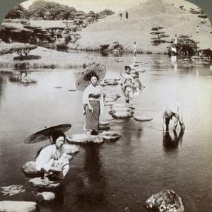Women Crossing the Lake on Stepping Stones, Suizen-Ji Garden, Kumamoto, Japan, 1904 by Underwood & Underwood