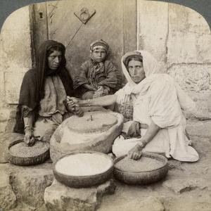 Women Grinding at the Mill, Palestine, 1900 by Underwood & Underwood