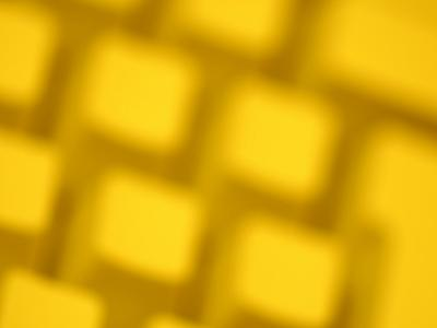 Unfocused Yellow Tinted Computer Keyboard--Photographic Print