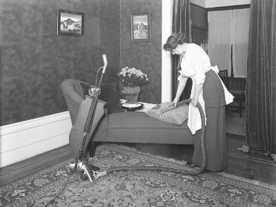 Unidentified Woman Demonstrating the Use of the Apex Vacuum Cleaner's Upholstery Attachment-William Davis Hassler-Photographic Print