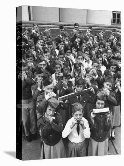 Uniformed Children Who Are Members of Levittown Harmonica Band Playing Harmonicas-Peter Stackpole-Stretched Canvas Print