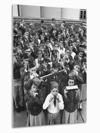 Uniformed Children Who Are Members of Levittown Harmonica Band Playing Harmonicas-Peter Stackpole-Metal Print