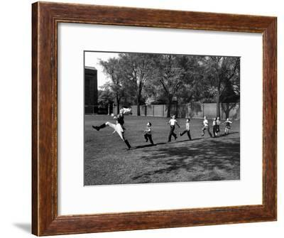 Uniformed Drum Major For University of Michigan Marching Band Practicing His High Kicking Prance-Alfred Eisenstaedt-Framed Premium Photographic Print