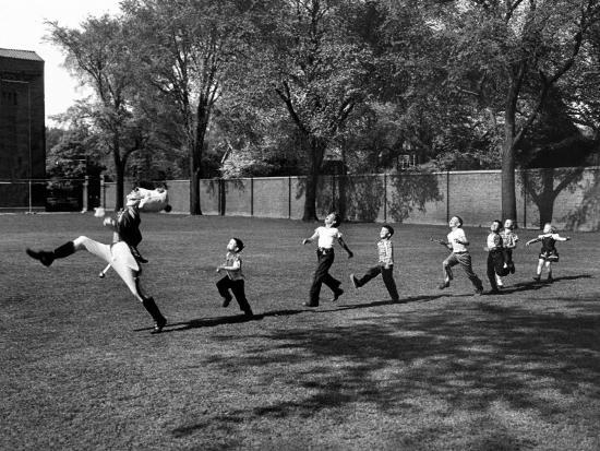 Uniformed Drum Major For University of Michigan Marching Band Practicing His High Kicking Prance-Alfred Eisenstaedt-Photographic Print