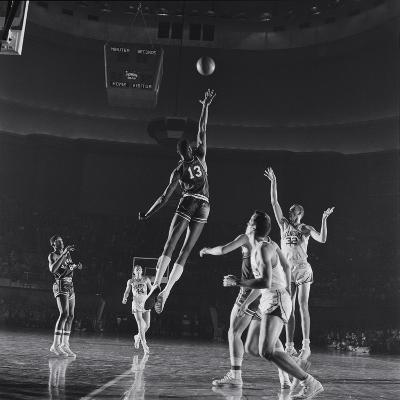 University of Kansas Basketball Player Wilt Chamberlain (C) Playing in a School Game, 1957-George Silk-Photographic Print