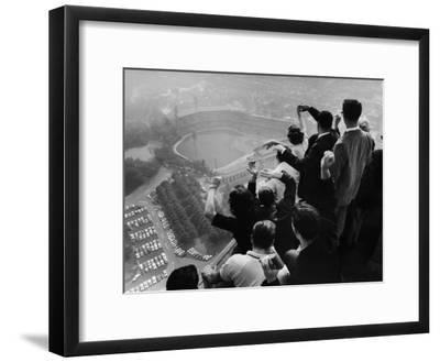 University of Pittsburgh Students Cheering Wildly from Atop Cathedral of Learning, School's Campus-George Silk-Framed Premium Photographic Print