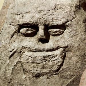 Stone head from pagan Celtic shrine at Cinderford, Gloucestershire. Artist: Unknown by Unknown