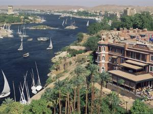Feluccas on the River Nile and the Old Cataract Hotel, Aswan, Egypt, North Africa, Africa by Upperhall Ltd