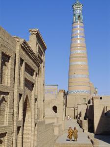 Islam Khodja Minaret, Prince Makhmud Mausoleum on Left, Khiva, Uzbekistan, Central Asia by Upperhall Ltd