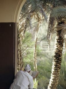 Man Reading Koran in Mosque, Malindi, Kenya, East Africa, Africa by Upperhall Ltd