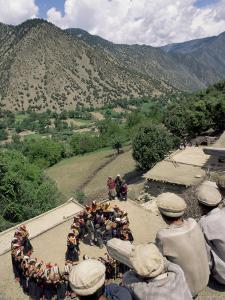 Men Watching Kalash Women Dancing, Spring Festival, Joshi, Bumburet Valley, Pakistan, Asia by Upperhall Ltd