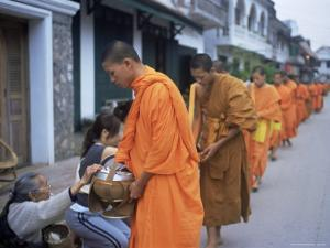 Novice Buddhist Monks Collecting Alms of Rice, Luang Prabang, Laos, Indochina, Southeast Asia, Asia by Upperhall Ltd
