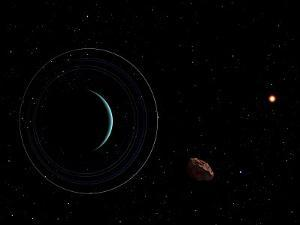 Uranus and Most of its Nine Major Rings Along with the Distant Sun and an Inner Satellite