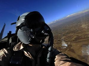 US Air Force Aerial Combat Photographer Watches for Threats to a F-15E Strike Eagle