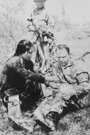 US Air Force Pilot Is Given First Aid by North Vietnam Captors in Jan. 1966--Photo