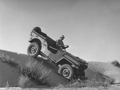 US Army Jeep Rolling Down a Sand Dune During Training Maneuvers in the Desert--Photographic Print