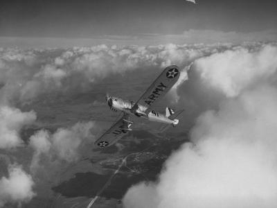 US Army's Ryan, Dragonfly, YO-51 Observation Plane Soaring Above the Clouds-Peter Stackpole-Photographic Print