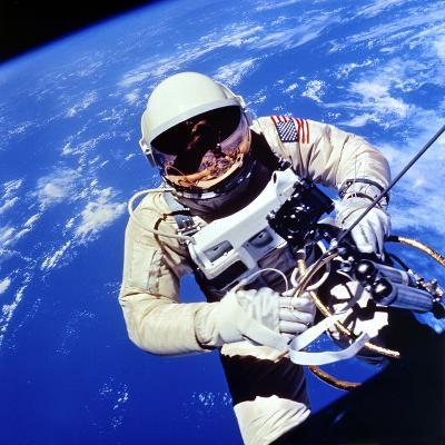 Us Astronaut Edward H. White II Carrying Out External Tasks--Photographic Print