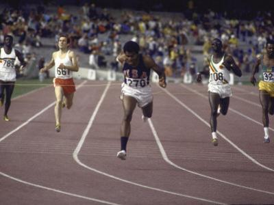 US Athlete Lee Evans Going Through Finish Line During Race at Summer Olympics