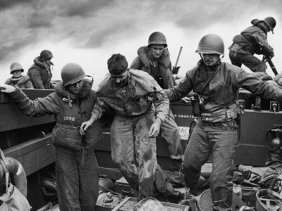 US Coast Guardsmen Assisting a Wounded Marine Returning from the Fight on Iwo Jima--Photographic Print