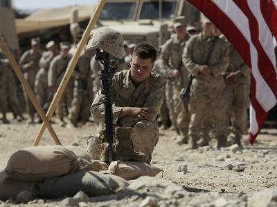 US Marine Pays His Respects to LCpl Joshua Bernard During a Memorial Service at Base in Afghanistan--Photographic Print
