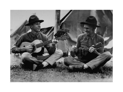US Marine Sitting on Ground and Playing Guitar--Photographic Print