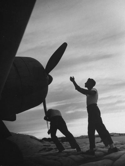 US Marines Pushing Through the Props of Bomber at US Naval Base on Midway Island-Frank Scherschel-Photographic Print