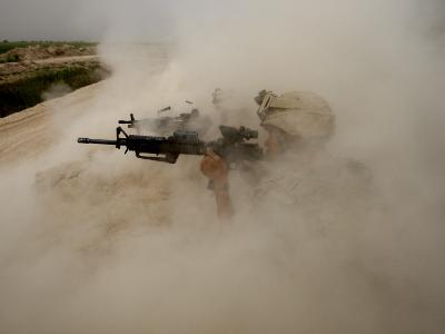US Marines Return Fire on Taliban Positions Near the Town of Garmser in Afghanistan--Photographic Print