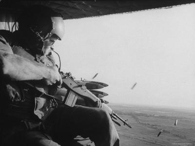 US Military Personnel Firing from Helicopters Onto Viet Cong Targets-Larry Burrows-Photographic Print