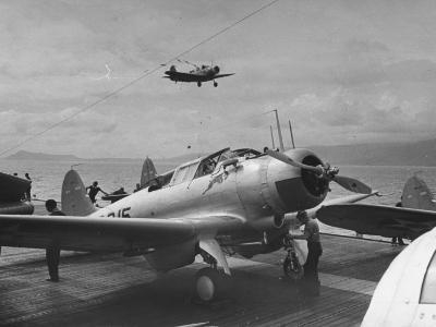 US Navy Bombers Sitting on Deck of Aircraft Carrier--Photographic Print