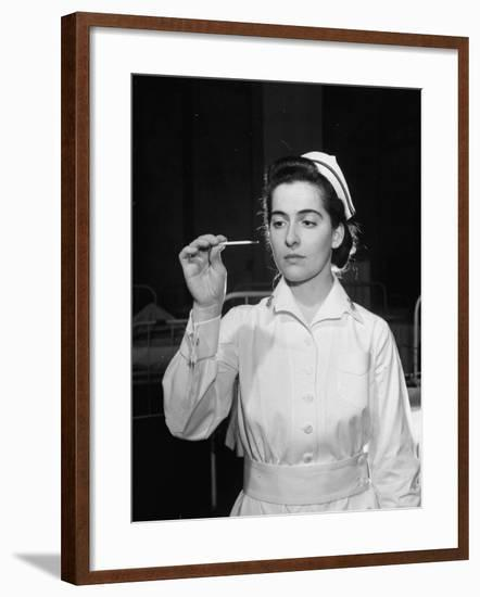 US Navy Nurse in Uniform Reading a Thermometer--Framed Photographic Print