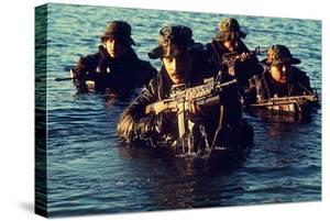 US Navy SEAL Team Emerges from Water During Warfare Training, Dec. 1, 1986
